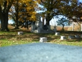 ORIGINAL PHOTO OF ME SITTING AT THE ANGEL STATUE AT CEDAR HILL CEMETERY