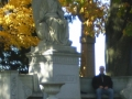 DARKER ASPECT SHOWING ME SITTING ON THE BENCH AND THE SPIRIT MAN TO MY LEFT  ON THE SIDE OF THE TALL STATUE