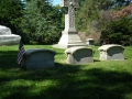 ORIGINAL PHOTO TAKEN AT THE SAMUEL COLT HEADSTONE SHOWING THE BEINGS NEAR THE TREES IN THE DISTANCE