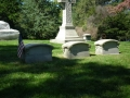 ORIGINAL SECOND PHOTO TAKEN AT THE SAMUEL COLT HEADSTONE SHOWING THE BEINGS NEAR THE TREES IN THE DISTANCE BUT BLURRY