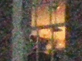 CENTER OF MANS FACE IS BEHIND THE VERTICAL PART OF THE WINDOW ON LEFT SIDE